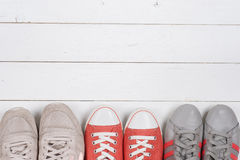 A picture of different shoes, Shot of several types of shoes, Several designs of  women shoes. Leather Shoe, Sport Shoe. Pile of v Royalty Free Stock Photos