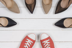 A picture of different shoes, Shot of several types of shoes, Several designs of  women shoes. Leather Shoe, Sport Shoe. Pile of v Stock Images