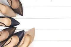 A picture of different shoes, Shot of several types of shoes, Several designs of women shoes. Leather Shoe, Sport Shoe. Pile of v. Arious female shoes on wooden stock photos