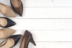 A picture of different shoes, Shot of several types of shoes, Several designs of women shoes. Leather Shoe, Sport Shoe. Pile of v. Arious female shoes on wooden stock images