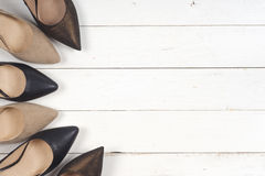 A picture of different shoes, Shot of several types of shoes, Several designs of women shoes. Leather Shoe, Sport Shoe. Pile of v. Arious female shoes on wooden royalty free stock images
