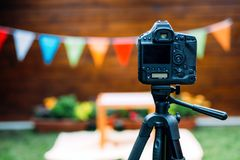 Picture of digital camera placed on tripod. Picture of black digital camera placed on tripod Royalty Free Stock Photo