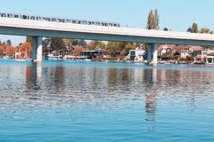 A picture of viennas subway traveling over the river. The Donau in Austria. stock images