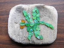 Green dragonfly made from sea glass, Lithuania stock image
