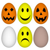 Eggs with easter and halloween smile - emoticon Stock Images