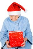 Christmas gift for a beautiful grandmother. Picture of an elderly woman holding a Christmas gift stock images