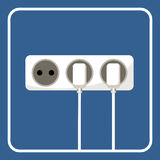 Picture of the electrical outlet on a blue background Stock Photo