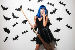 Shocked young woman in witch halloween costume Stock Photos