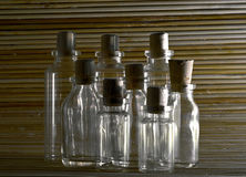 Empaty Bottles on wooden background. Picture of Empaty bottles on wooden background royalty free stock photography