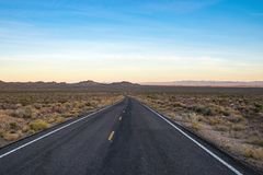 County road in Arizona, USA. Picture of an empty county road in the desert in Arizona, USA stock images