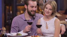 Picture of engaged couple with wine glasses stock video footage