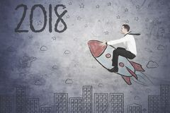 European businessman flying toward numbers 2018 stock image