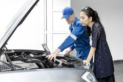 European mechanic talking to owner car Royalty Free Stock Photo