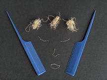 A picture of a face made with dried garlic roots and blue combs Royalty Free Stock Photo