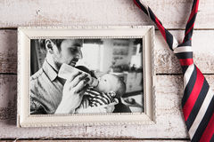 Picture of father feeding baby son. Fathers day. Studio shot. Royalty Free Stock Photography