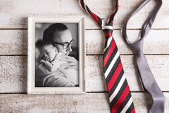 Picture of father holding baby son. Fathers day. Studio shot. Stock Image