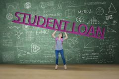 Female college student lifting student loan word royalty free stock photos