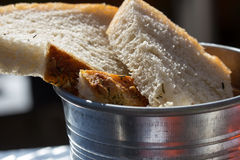 Olive bread in metal bucket Stock Photography