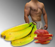 Picture of a fit, muscular body, fruits Royalty Free Stock Photo