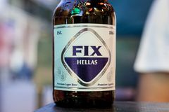 Close up on a bottle of Fix Beer in a traditionnal glass bottle at night. Fix, or Fix Hellas, is the main Greek beer. Picture of Fix Hellas Beer. FIX is a brand royalty free stock image