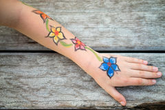Picture of flowers on the child's hand. Stock Photography