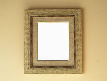 Picture frame. Vintage wooden picture frame on wall background Stock Image