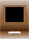 Picture frame. Empty vintage picture frame on the wall of the gallery Royalty Free Stock Image