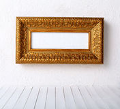 Picture frame. Ancient structure on a white wall royalty free stock image