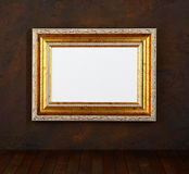 Picture frame. Old frame over the grunge wall background stock image
