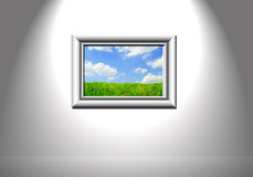 Picture frame. Picture of white wall with picture of landscape stock photography