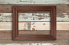 Picture frame. Retro picture frame on wooden wall Stock Image