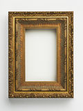 Picture frame. Ornate antique gold picture frame on white Royalty Free Stock Photos