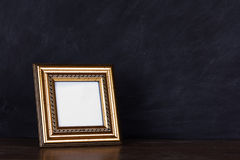 Picture frame against a dirty blackboard background Royalty Free Stock Photo