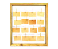 Picture frame and antique note papers on white background Royalty Free Stock Photography