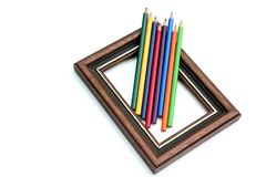 Picture frame and artist's pencils Royalty Free Stock Photo