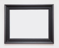 Picture frame. Blank black picture frame on white wall Stock Photo