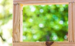 Picture frame on blurred tree backgroud using wallpaper or background for idea work. stock photo