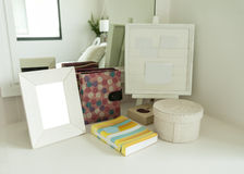 Picture frame and book on a table Stock Image