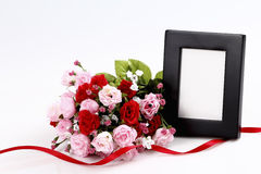 Picture frame with bouquet Royalty Free Stock Photo