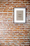 Picture frame on the brick wall texture. Royalty Free Stock Images