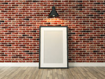 Picture frame on the brick wall and wood floor under spot light. Picture frame on the red brick wall and wood floor under spot light for picture, background Royalty Free Stock Images