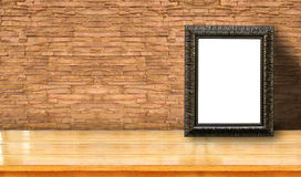 Picture frame on brick. Picture frame with white blank space use for pictures or texts display on old brick background Royalty Free Stock Images
