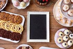Picture frame and cake, cookies, cakepops, cupcakes. Copy space. Royalty Free Stock Image