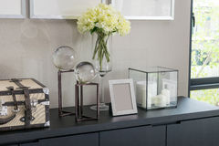 Picture frame and candle lamp on a table. In a contemporary room Stock Photography