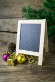 Picture Frame and Christmas decorations on old wooden background stock photo