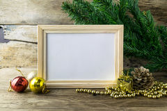 Picture Frame and Christmas decorations on old wooden background stock photos