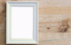 Picture frame. Close up white picture frame put on wooden wall background with space use for picture or texts display Stock Photography
