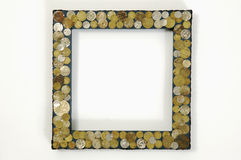 Picture frame with coins Royalty Free Stock Images