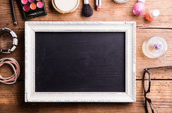 Picture frame with copy space, various make-up products Royalty Free Stock Images