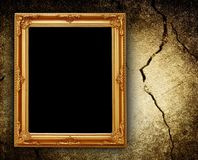 Picture frame on cracked wall Stock Photography